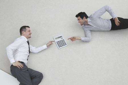 Two Businessmen Using Calculator,Side View,Elevated View,Portrait LANG_EVOIMAGES