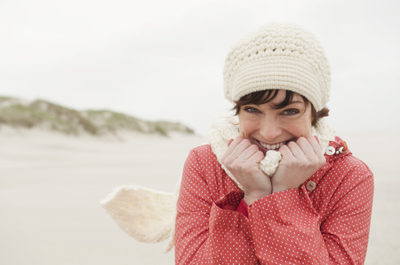 scarves: Germany,St Peter-Ording,North Sea,Woman Having Fun In Sand Dunes,Smiling,Portrait