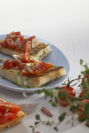 Ciabatta Bread With Slices Of Tomato And Onion In Plate LANG_EVOIMAGES