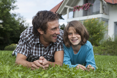 Germany,Munich,Father And Son (10-11 Years) In Garden,Smiling LANG_EVOIMAGES