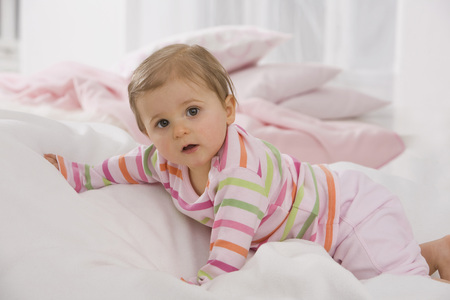 Baby Girl (6-11 Months) Crawling On Blanket
