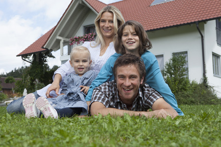 Germany,Munich,Family In Front Of House,Smiling,Portrait