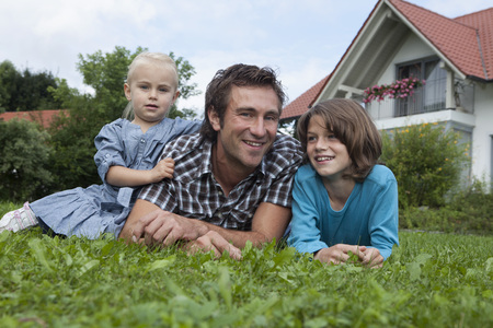 Germany,Munich,Father With Children In Garden,Smiling LANG_EVOIMAGES