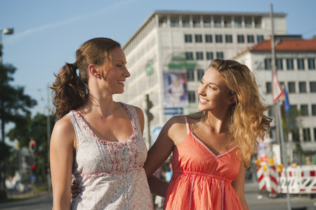 Germany,Munich,Karlsplatz,Young Women Smiling And Having Fun Together