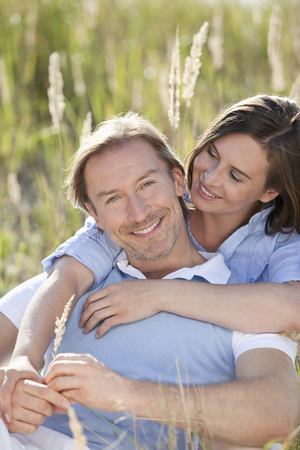 Germany,Bavaria,Man And Woman Embracing In Meadow,Smiling