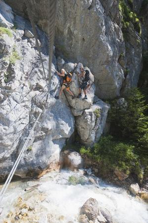 roped: Austria,Steiermark,Ramsau,Silberkarklamm,Young Couple Rock Climbing LANG_EVOIMAGES