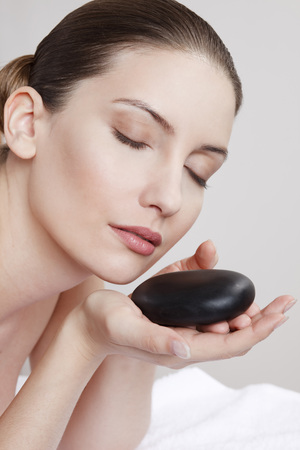 Close Up Of Woman With Hot Stone,Eyes Closed