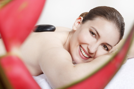 lastone therapy: Woman Having A Hot Stone Treatment,Smiling,Portrait LANG_EVOIMAGES