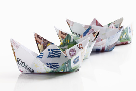 Origami Paper Boats Of Euro Notes On White Background LANG_EVOIMAGES
