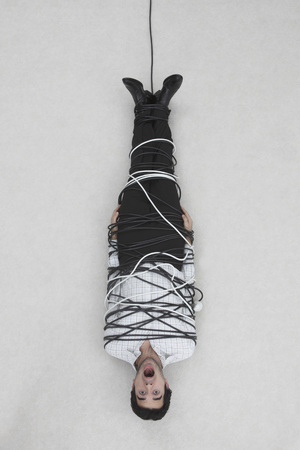 Businessman Tied Up With Computer Cable,Elevated View