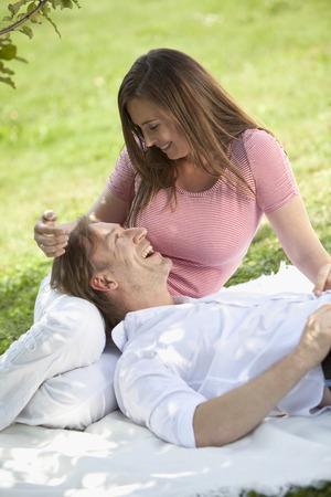 cheerfulness: Germany,Bavaria,Couple Having Picnic,Man Lying On WomanS Lap