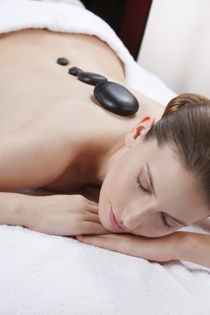Woman With Eyes Closed Having Lastone Therapy