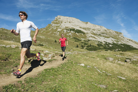 2 way: Austria,Kleinwalsertal,Man And Woman Running On Mountain Trail