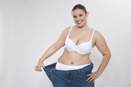 Young Chubby Woman With Oversized Pant,Portrait