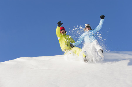 Italy,Trentino-Alto Adige,Alto Adige,Bolzano,Seiser Alm,Man And Woman Jumping On Snow