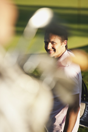 Italy,Kastelruth,Golfers In Golf Cart On Golf Course,Smiling LANG_EVOIMAGES