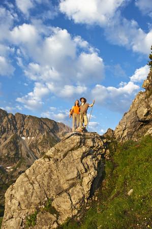 Austria,Salzburg Country,Altenmarkt-Zauchensee,Couple Hiking On Mountains Of Niedere Tauern
