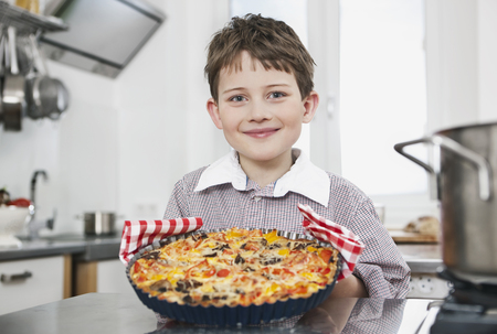 Germany,Cologne,Boy Holding A Pizza,Smiling,Portrait