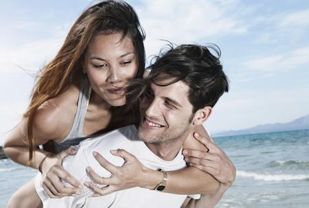 mallorca: Spain,Majorca,Young Man Carrying Woman On Back At Beach