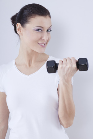 Close Up Of Mid Adult Woman With Barbells Against White Background,Smiling,Portrait