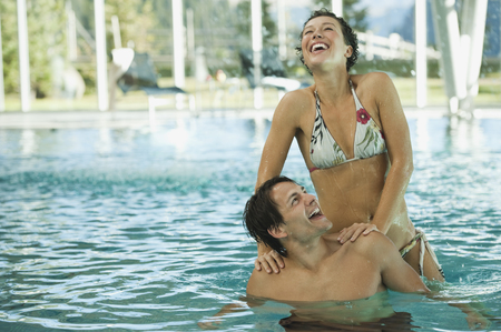 looking for love: Italy,Southtyrol,Couple In Swimming Pool Of Hotel Urthaler