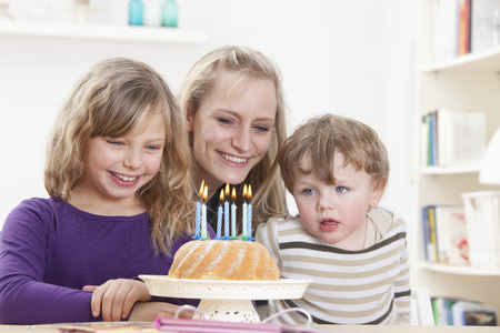 sweet seventeen: Germany,Bavaria,Munich,Mother,Daughter And Son With Birthday Cake