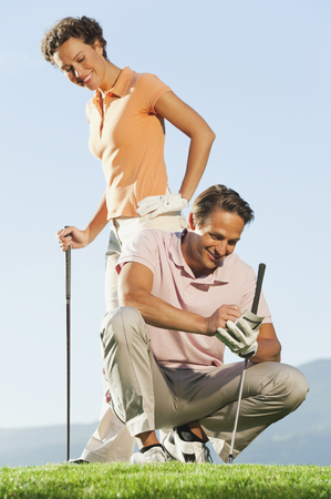 cowering: Italy,Kastelruth,Golfers On Golf Course,Smiling