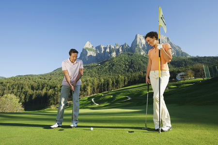 Italy,Kastelruth,Golfers Playing Golf On Golf Course