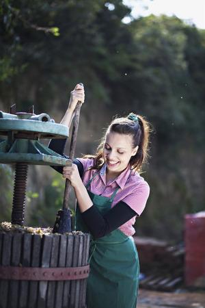 Croatia,Baranja,Young Woman Crushing Grapes