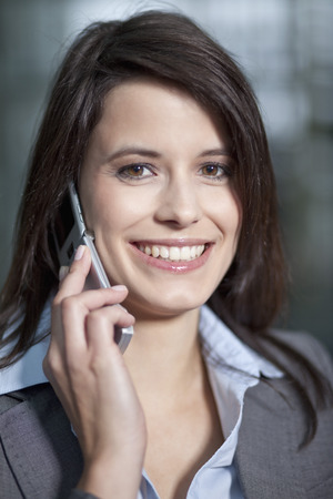 Germany,Bavaria,Business Woman On The Phone,Smiling,Portrait LANG_EVOIMAGES
