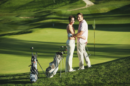 Italy,Kastelruth,Mid Adult Couple On Golf Course,Smiling,Portrait