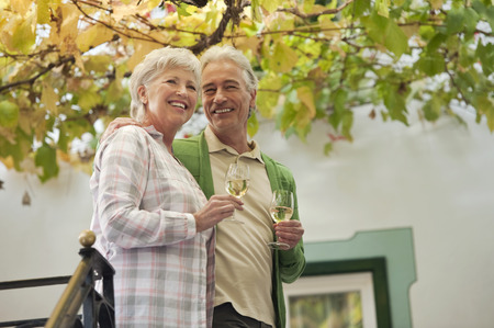 Italy,South Tyrol,Mature Couple With Wine Glass At Guesthouse
