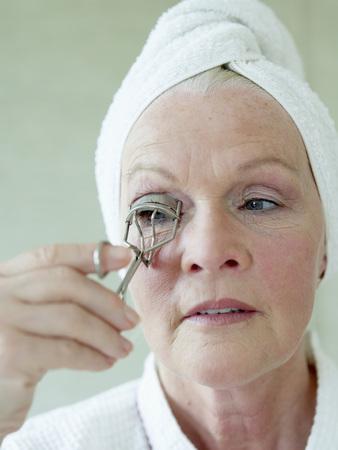 Senior Woman Shaping Eyelashes With Eyelash Curler,Close Up