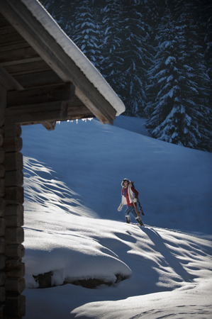 Austria,Salzburg Country,Flachau,Young Woman Walking With Sledge In Snow LANG_EVOIMAGES