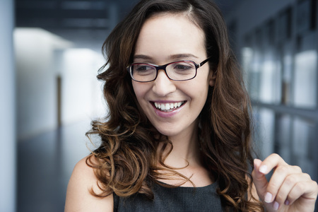 Germany,Bavaria,Diessen Am Ammersee,Close Up Of Businesswoman In Thick Spectacles,Smiling LANG_EVOIMAGES