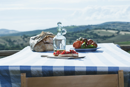 Italy,Tuscany,Magliano,Bruschetta,Bread,Tomatoes And Olive Oil On Table LANG_EVOIMAGES