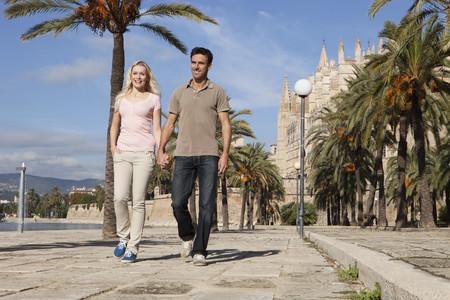palma: Spain,Mallorca,Palma,Couple Walking Along Allee,Smiling