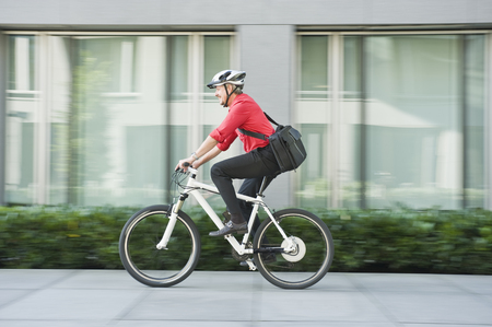 Germany,Bavaria,Mature Man Riding Bicycle