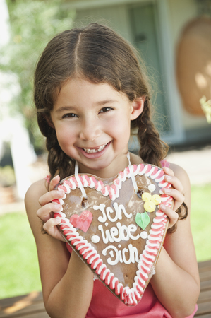 Germany,Bavaria,Girl With Gingerbread Heart,Smiling,Portrait