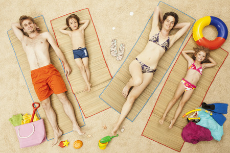 feet naked: Germany,Artificial Beach Scene With Family Lying On Mat
