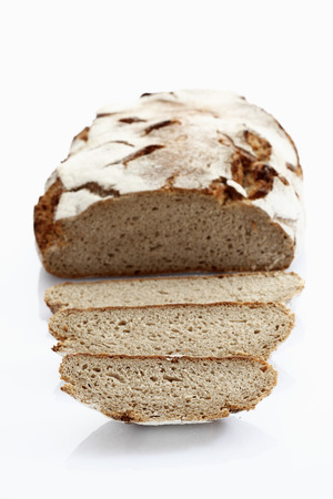 Rye Bread Loaf With Slice On White Background,Close Up