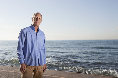 over the edge: Spain,Mallorca,Senior Man Standing At Sea Shore,Portrait