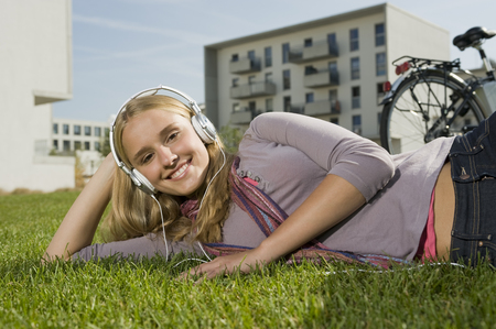 hands free phone: Germany,Bavaria,Teenage Girl Listening Music,Smiling,Portrait