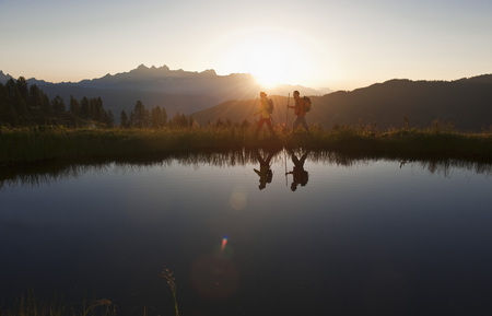 Austria,Salzburg,Couple Walking Near Mountain Lake At Sunrise