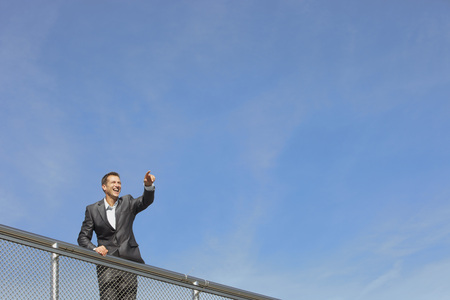 Germany,Bavaria,Munich,Businessman Standing Near Railings,Smiling LANG_EVOIMAGES