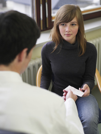 Germany,Hamburg,Patient Receiving Prescription From Doctor In Clinic LANG_EVOIMAGES