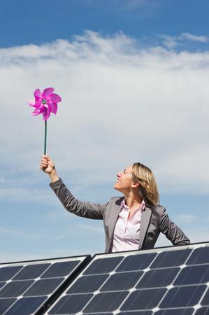 Germany,Munich,Woman Holding Paper Windmill,Smiling