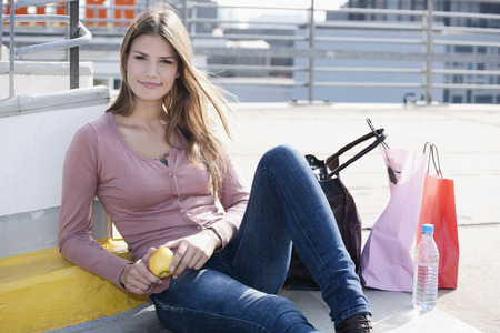 Germany,Cologne,Young Woman With Shopping Bags,Smiling,Portrait LANG_EVOIMAGES