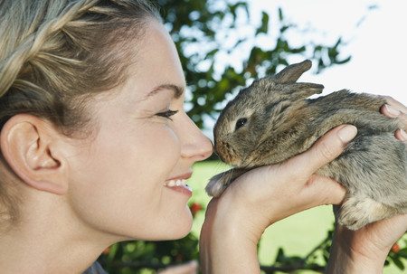 leporidae: Italy,Tuscany,Young Woman Holding Rabbit,Close Up LANG_EVOIMAGES