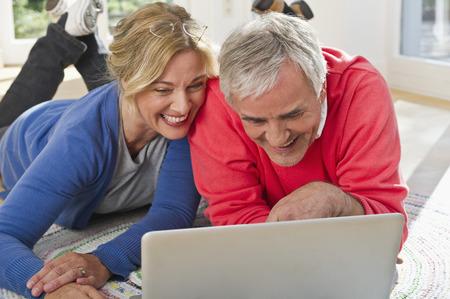 Germany,Bavaria,Grobenzell,Couple Using Laptop,Smiling